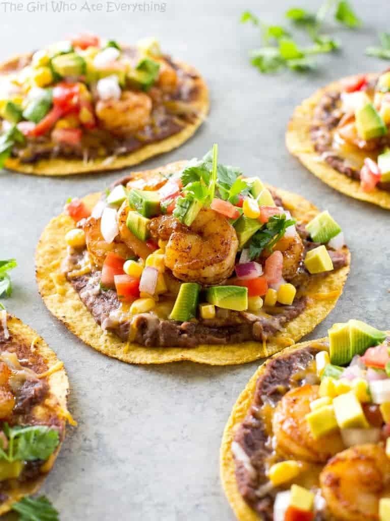 Shrimp Tostadas with black beans, avocado, onions, tomatoes, and cilantro. the-girl-who-ate-everything.com